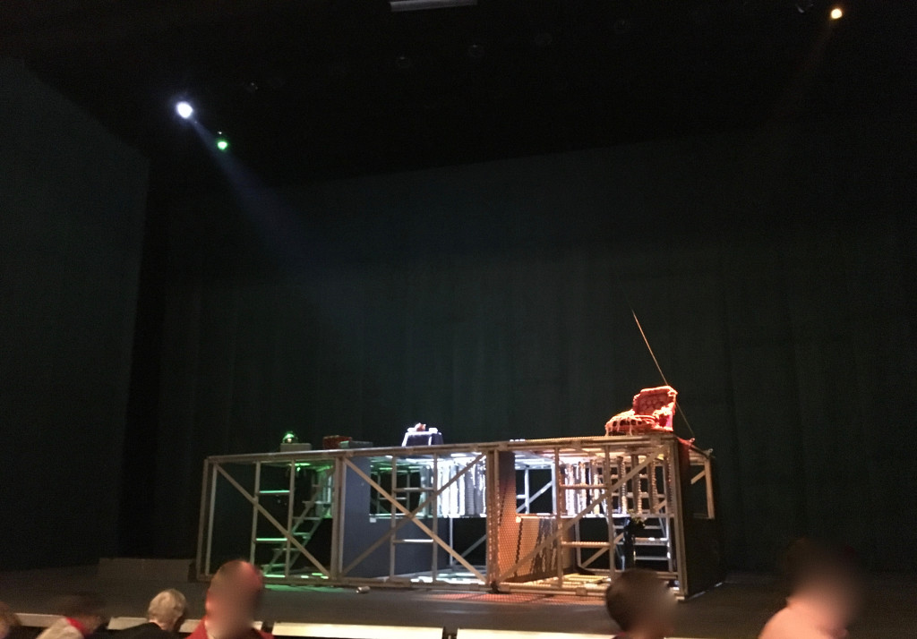 Act 4 set (the tower of scaffolding has fallen). My own illicit snapshot. All the production photos are awful, completely misrepresenting the spaciousness of the set.